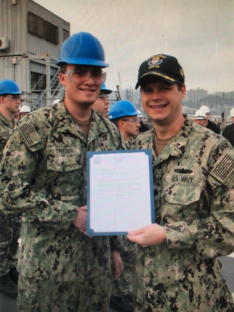 FIREFIGHTER MATTHEW SNYDER RECEIVES NAVY ADVANCEMENT